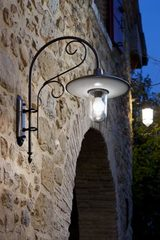 Large outdoor wall lamp with curved porcelain and patinated brass. Aldo Bernardi.