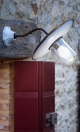 Patina brass and porcelain outdoor wall light with clear glass. Aldo Bernardi.