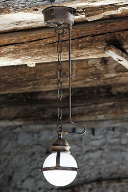 Frosted globe pendant with chain and tube in aged patinated brass. Aldo Bernardi.
