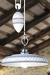 Provence style pendant with blue crosses and border white porcelain and counterweight. Aldo Bernardi.