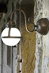Frosted globe wall lamp in aged patinated brass. Aldo Bernardi.