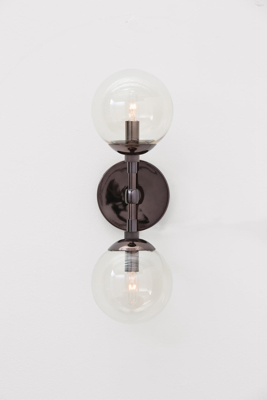 Applique double boule en verre et métal brun Polaris . Arteriors.