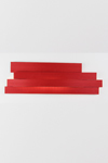 Long red wall lamp in pressed cellulose. Arturo Alvarez.