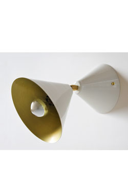 White lacquered cone wall light with golden interior. Atelier Areti.