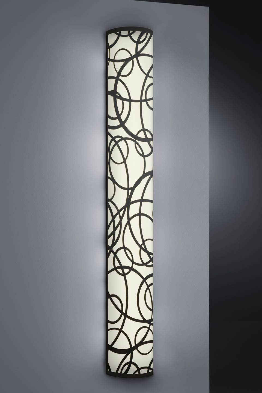 Applique bronze antique motifs en cercles forme demi-cylindre. Baulmann Leuchten.