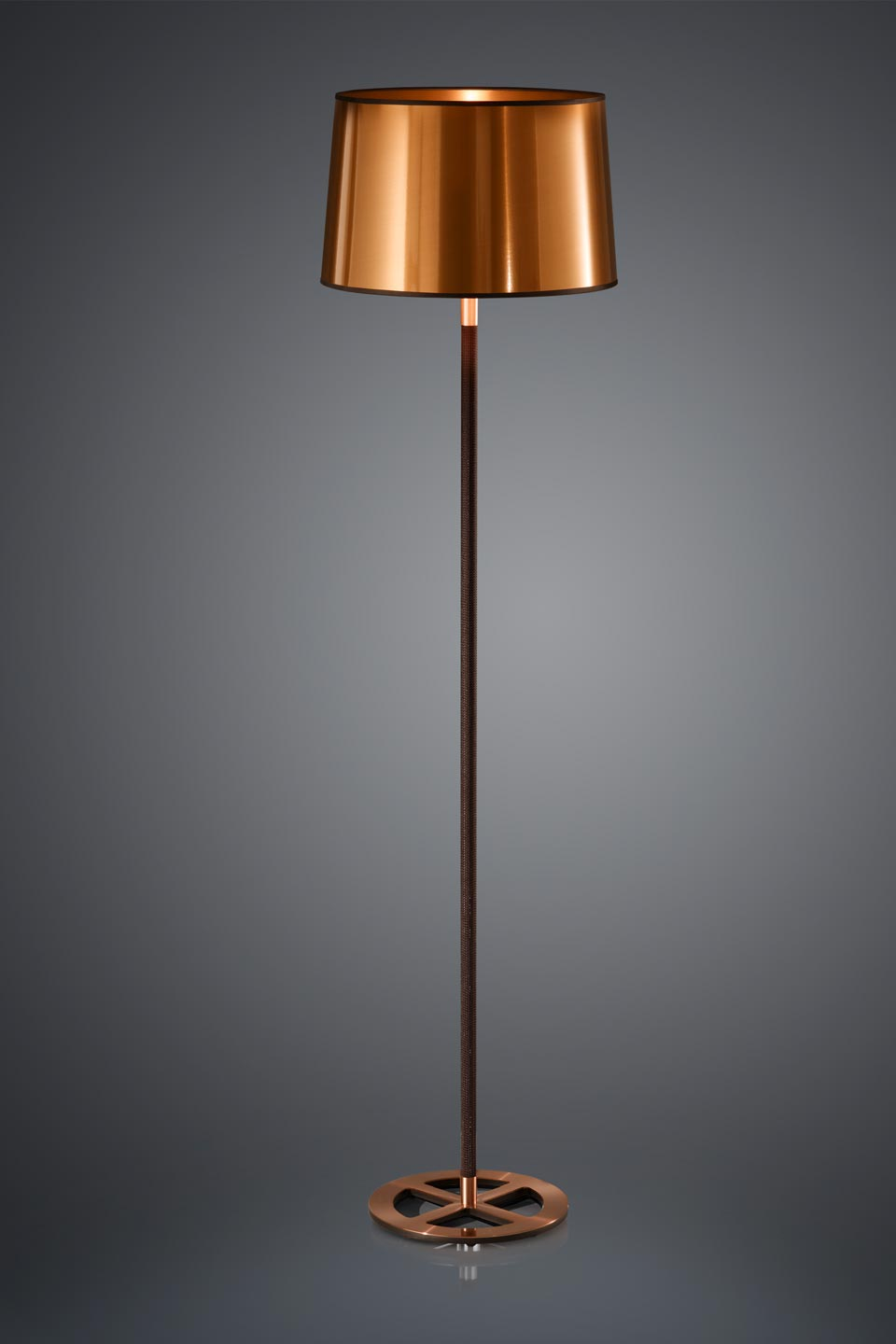 Black floor lamp with lampshade in cylindrical copper sheet. Baulmann Leuchten.