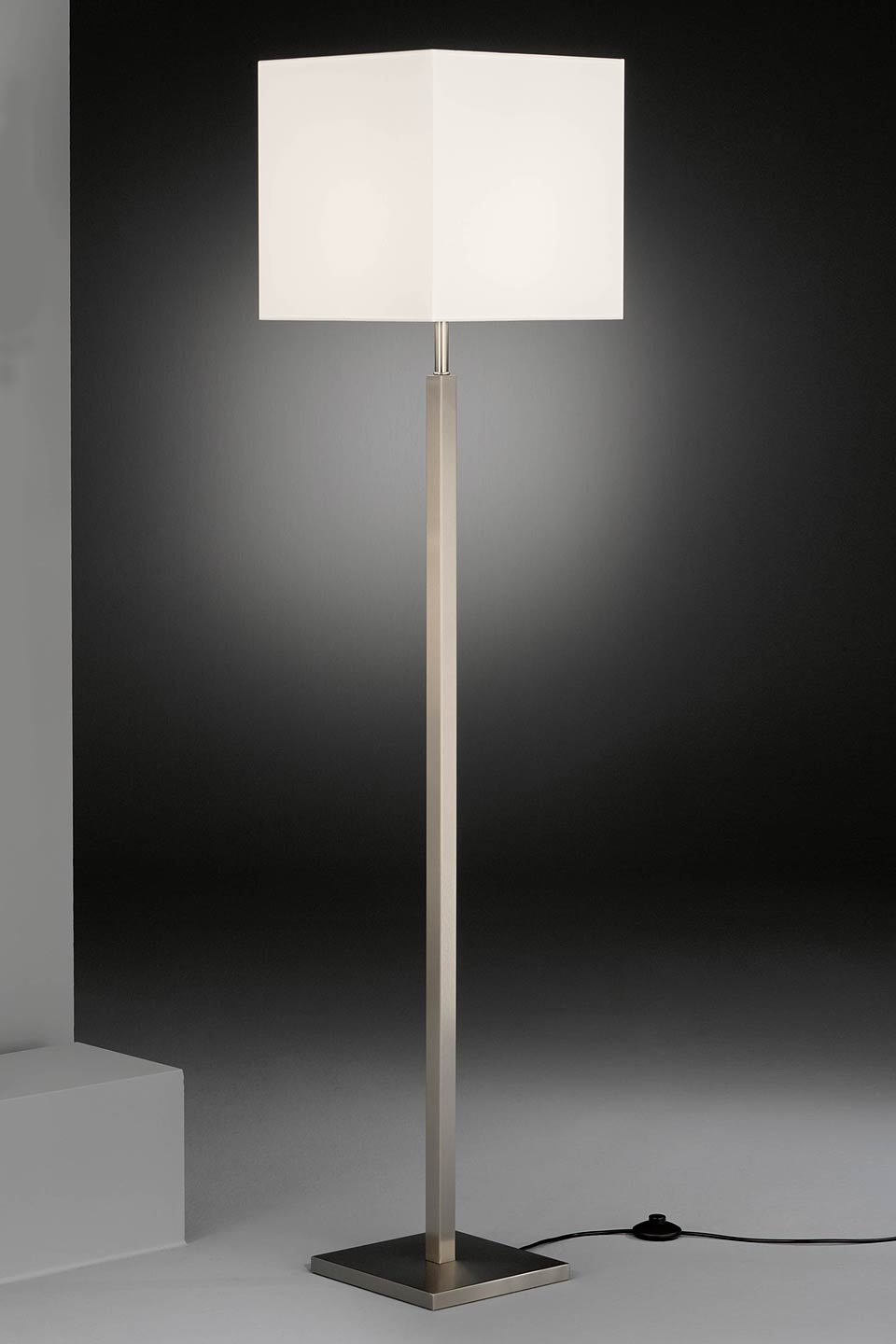 Square nickel plated floor lamp with white chintz lampshade. Baulmann Leuchten.