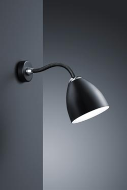 Black wall lamp with a flexible arm. Baulmann Leuchten.