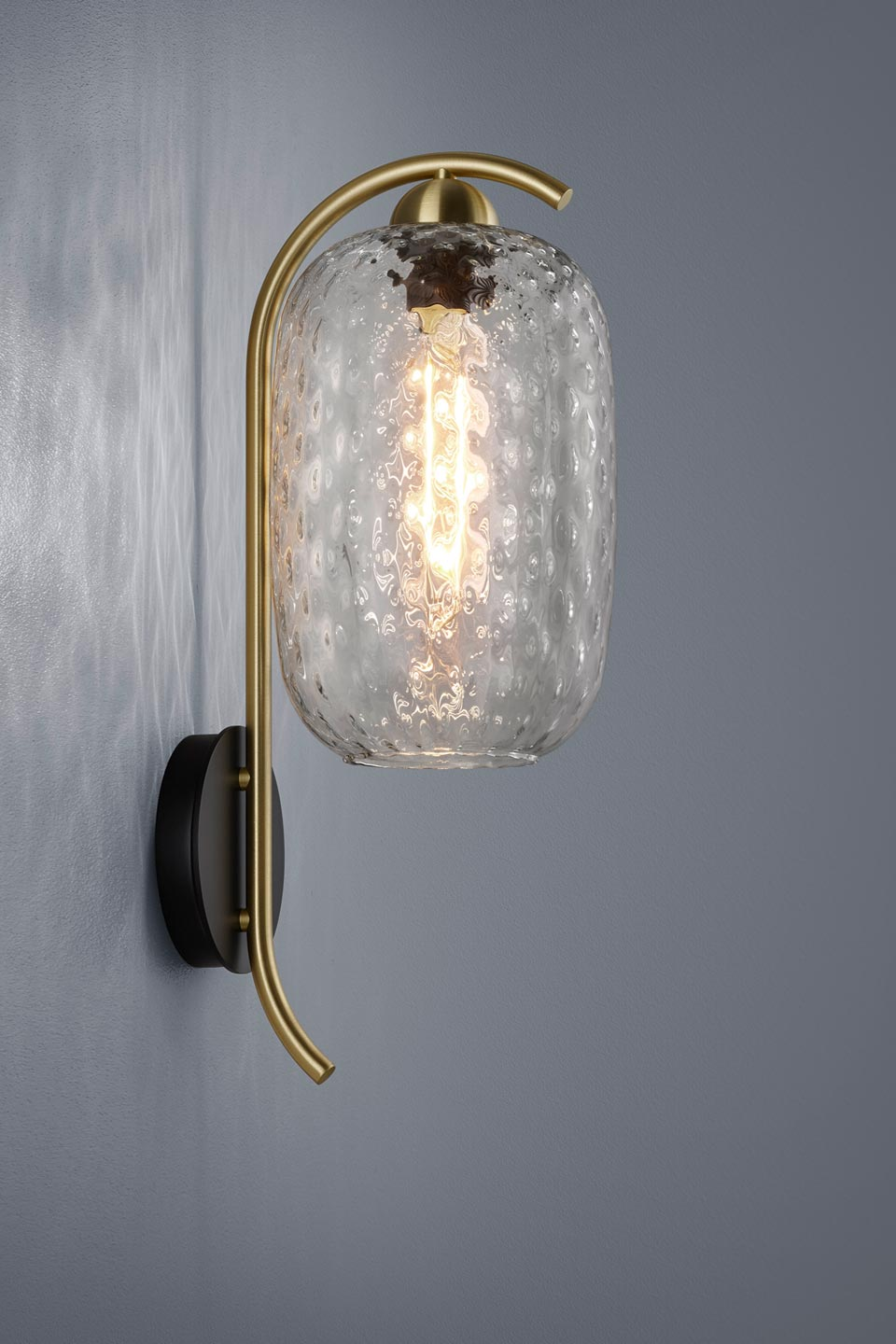 Golden and design wall lamp with carved glass. Baulmann Leuchten.
