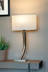 Bright nickel lamp with curved foot L150. Casadisagne.