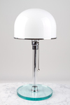 Table lamp in glass and chromed metal. Contract&More.