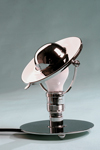 Small chrome metal table lamp with reclining lampshade. Contract&More.