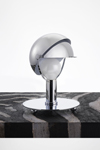 Small table lamp helmet in chromed metal. Contract&More.