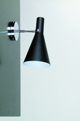 Black wall lamp in conical shape, white interior. Contract&More.