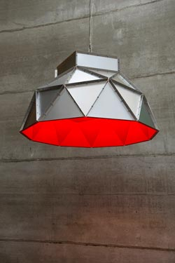 Apollo large stainless steel pendant with red interior. Dark.