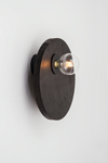 Large wall lamp in intense black wood. Dark.