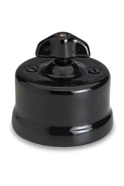 Garby interrupteur porcelaine noire rotatif en applique à oreillette va et vient. Fontini.