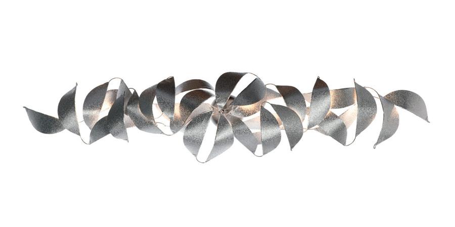 Réflexion applique horizontale ou verticale en métal texturé. Harco Loor.