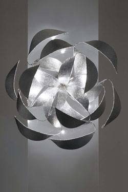 Réflexion  applique ou plafonnier métal 12 lumières. Harco Loor.