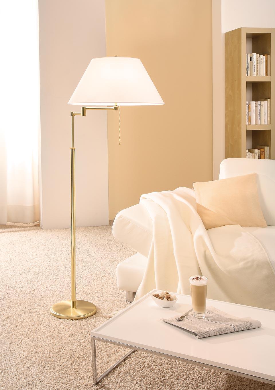 Lampadaire à chaînette ajustable en hauteur métal doré mat et brillant abat-jour blanc. Holtkötter.