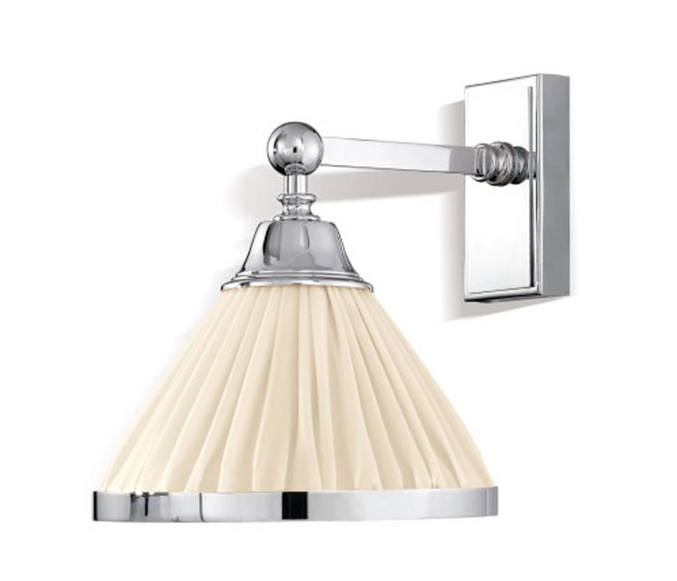 Brooklyn chrome wall lamp and ivory pleated silk conical shade. Jacques Garcia.