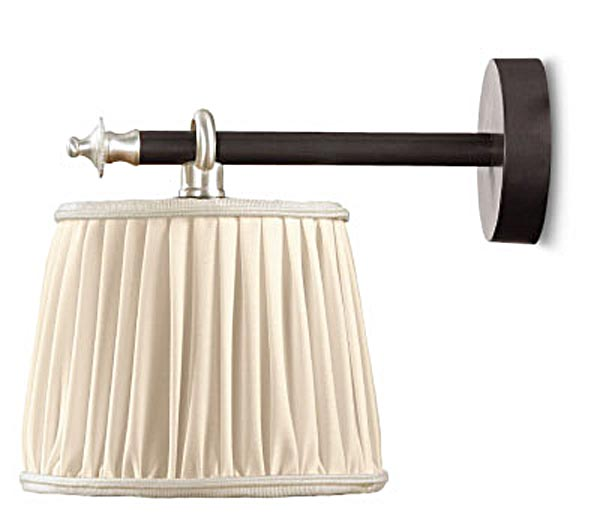 Joseph bronze antique wall lamp and ivory pleated silk lampshade. Jacques Garcia.