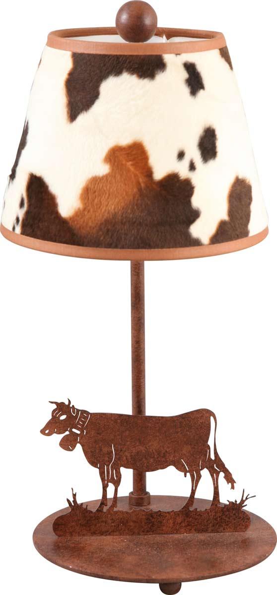 Lampe avec motif vache en métal rouillé