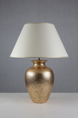 Hella black and gold amphora shaped table lamp. Le Dauphin.