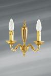 Applique en bronze Louis XVI patiné vieil or, deux bougies. Lucien Gau.