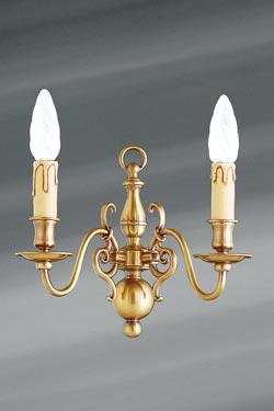 Applique laiton style hollandais deux lumières . Lucien Gau.