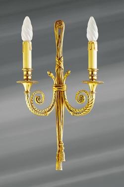 Applique Louis XVI finition vieil or, double bougeoir.. Lucien Gau.