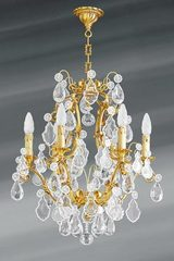 Golden Louis XV chandelier with bohemian crystal six lights. Lucien Gau.