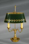 Lampe en bronze massif de style Louis XVI, deux lumières, avec abat-jour ovale peint en vert. Lucien Gau.