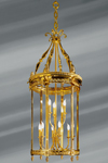 Lanterne de style Louis XVI en bronze massif et verre bombé, neuf lumières sur deux étages. Lucien Gau.