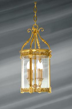 Lanterne en verre et bronze massif travaillé de style classique à quatre lumières . Lucien Gau.