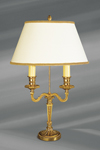 Louis XVI style lamp in solid gilt bronze with oval shade, white, smooth and laced. Lucien Gau.