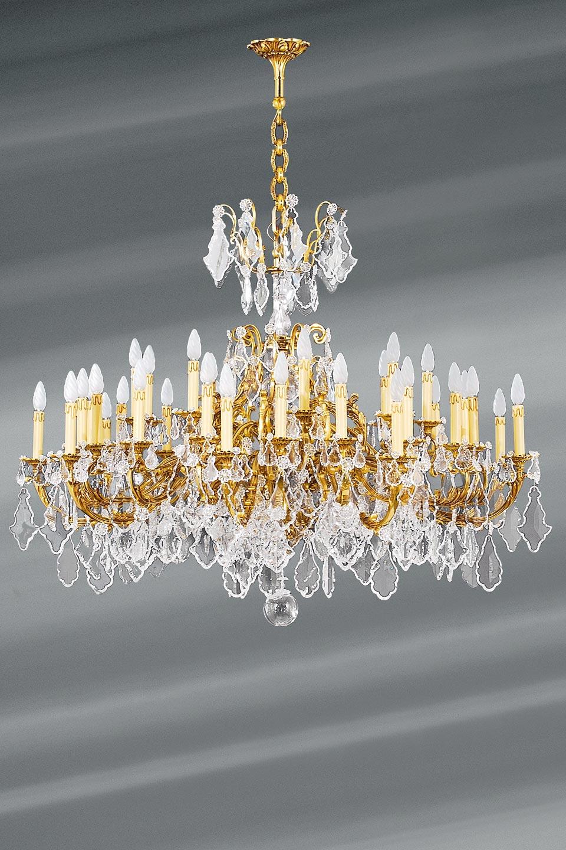 Lustre bronze doré et cristal Louis XV 36 lumières. Lucien Gau.