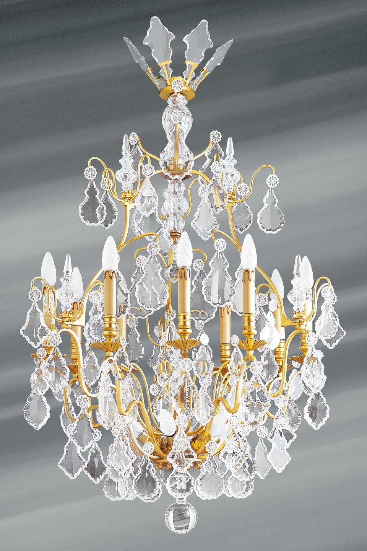Lustre doré cristal de bohème Louis XVI forme cage quinze lumières. Lucien Gau.