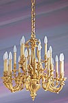Lustre doré Louis XV bronze vingt lumières. Lucien Gau.