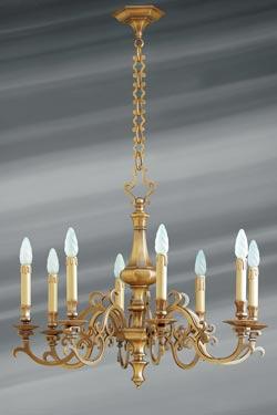 Lustre Louis XIII bronze massif huit lumières. Lucien Gau.
