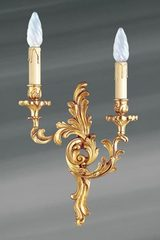 Golden Louis XV wall light in solid bronze. Lucien Gau.