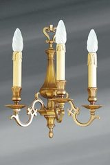 Louis XIII solid bronze three lights sconce. Lucien Gau.
