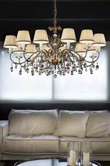 Matt old-gold crystal chandelier with cream shades. Masiero.