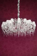 White, chrome-plated metal and clear crystal designer chandelier . Masiero.