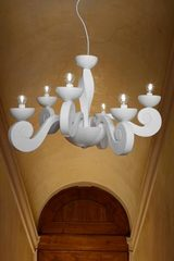 White contemporary chandelier in scrolls Botero 10 lights. Masiero.
