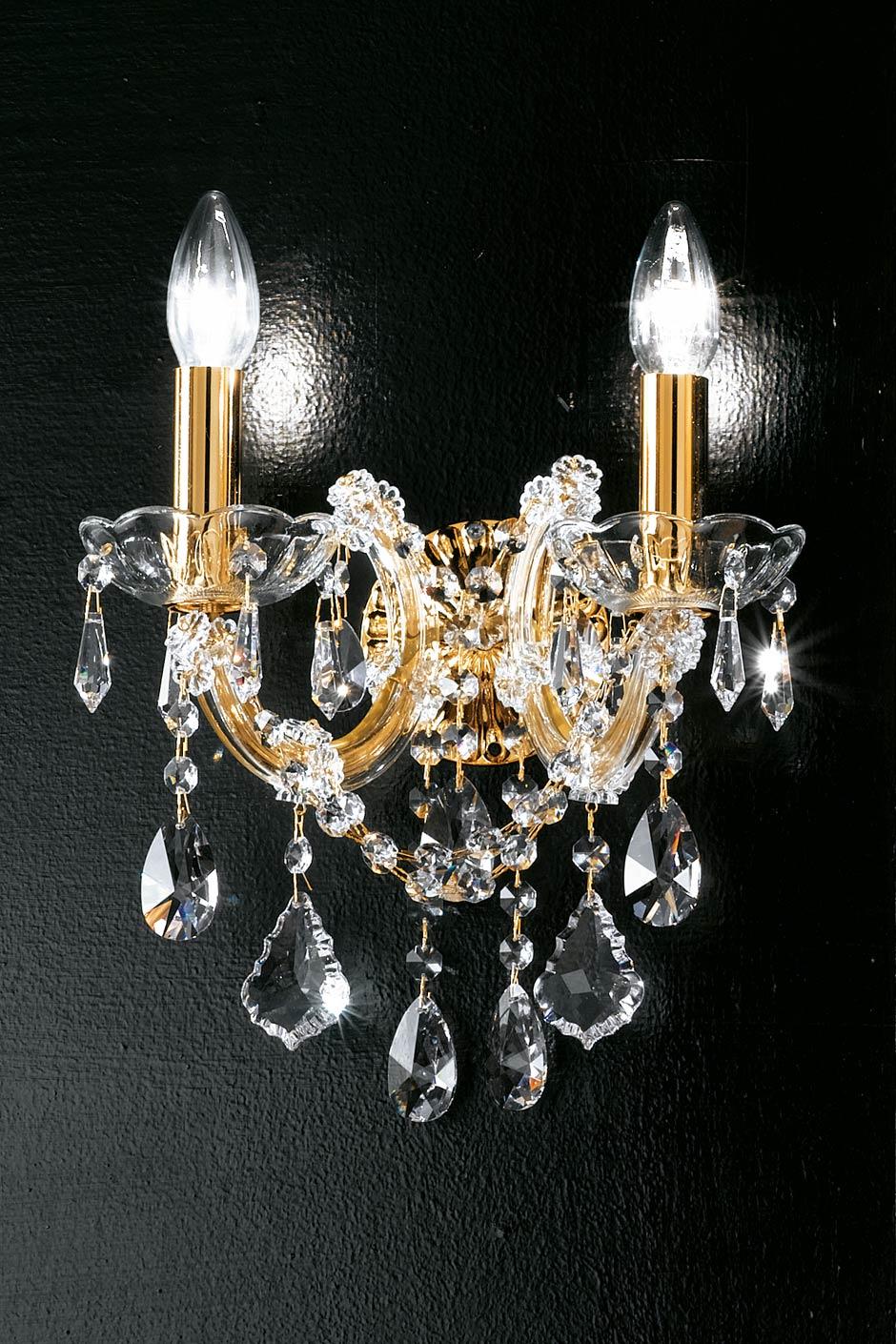 Applique double en cristal transparent et métal doré simple volute. Masiero.