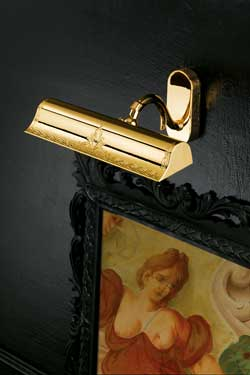 Flared polished gold-plated picture light with classical decoration. Masiero.