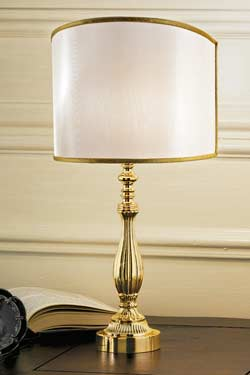 Gold-plated bronze table lamp with pale-beige shade. Masiero.