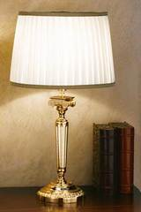 Gold-plated bronze table lamp with round base. Masiero.