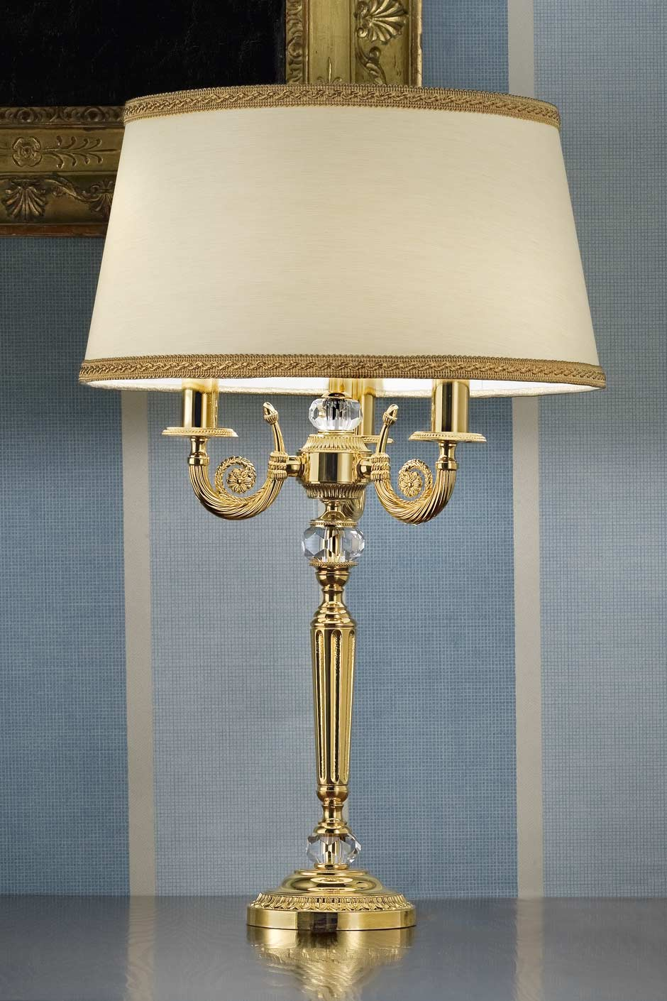 Gold-plated metal table lamp with crystal details . Masiero.